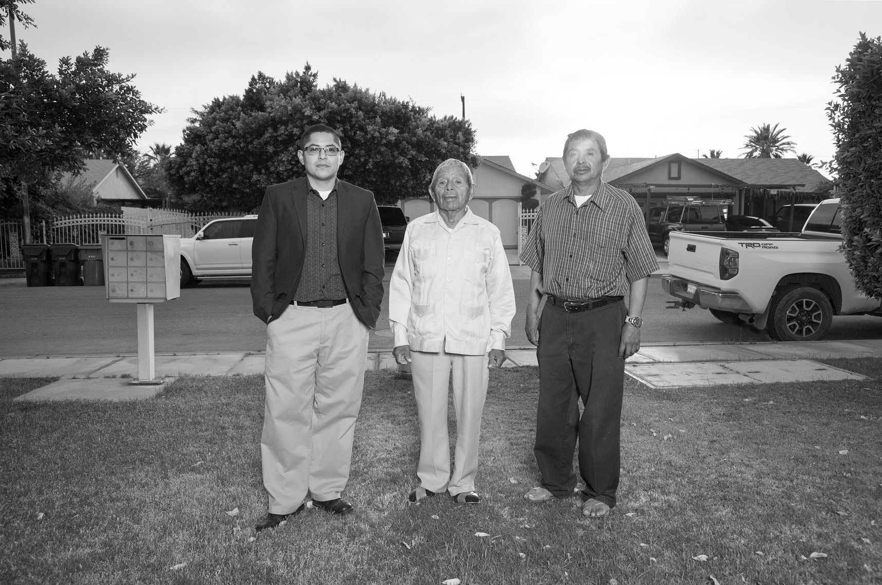 Castulo, Onesimo and Jeronimo Estrada standing in front of their family home in Coachella, Ca.