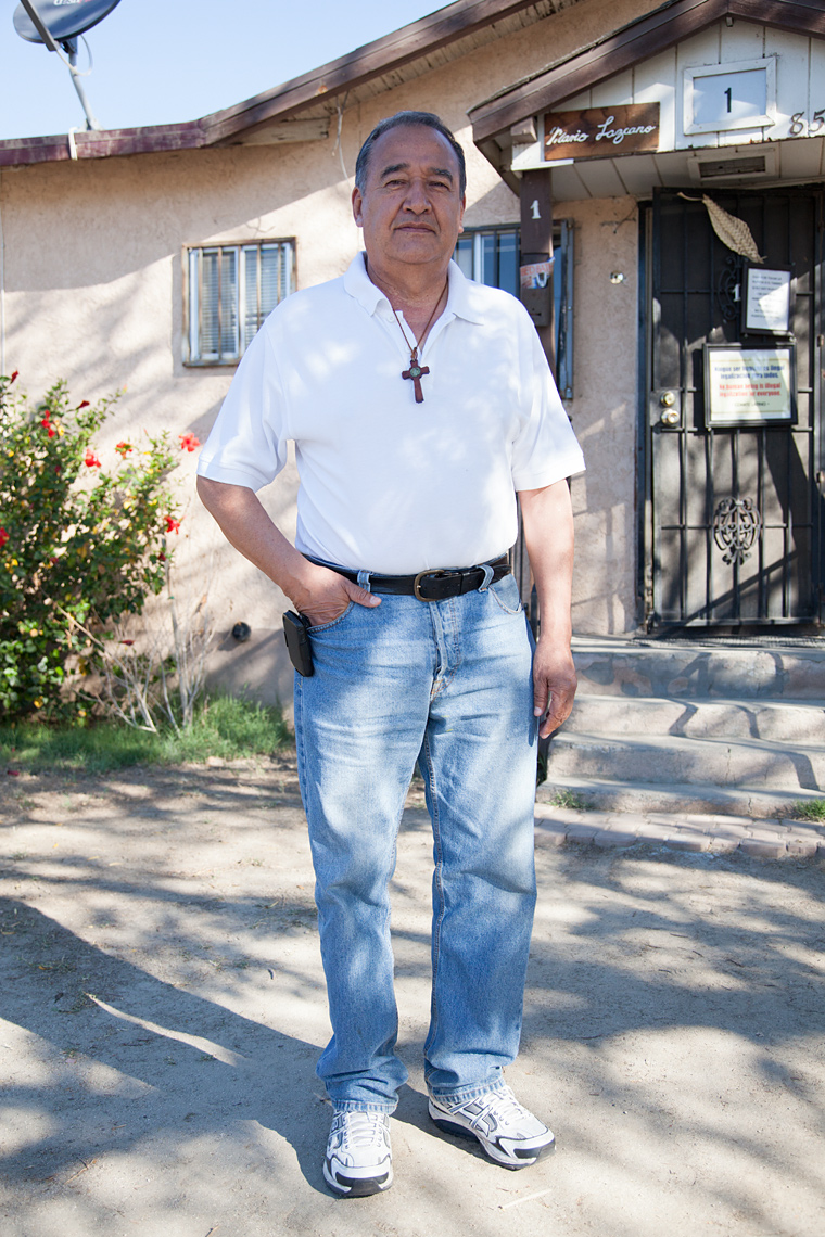 Portrait of Jose Mario Lazcano outside of his home in Coachella, Ca.