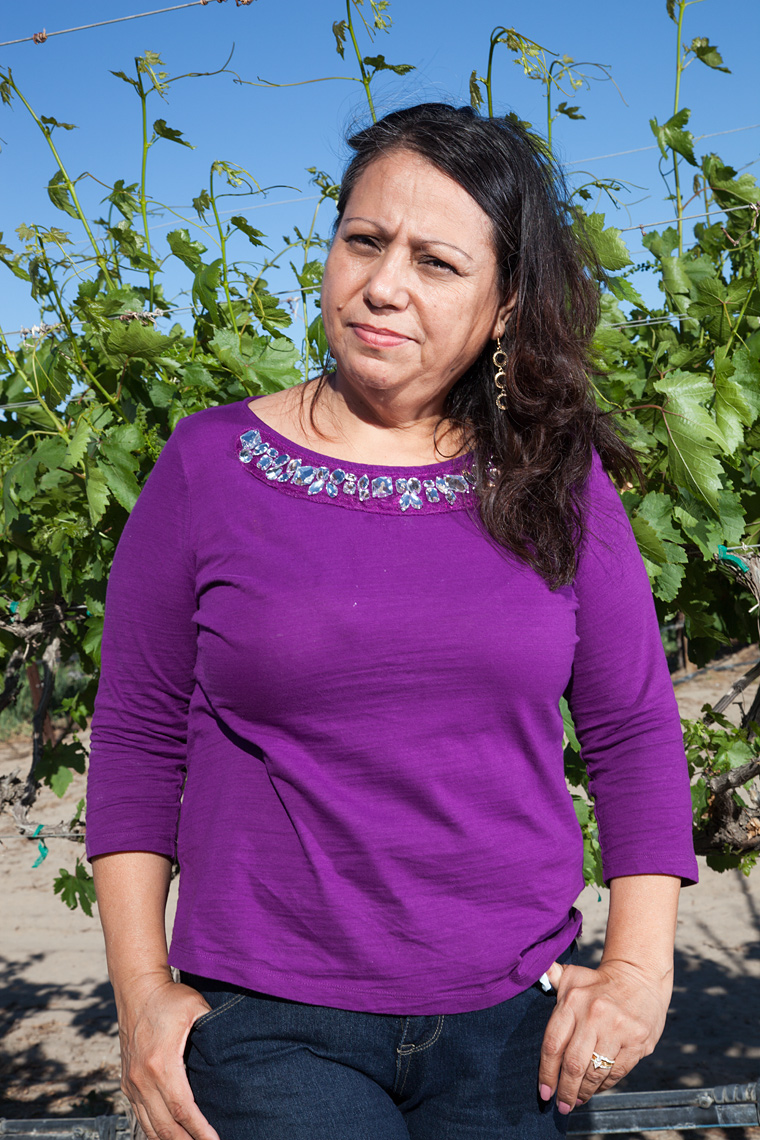 Portrait of Ramona Felix in a grapevine just outside Mecca, CA.
